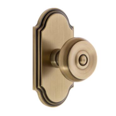 Grandeur Bouton Door Knob Set with Arc Rose in Vintage Brass