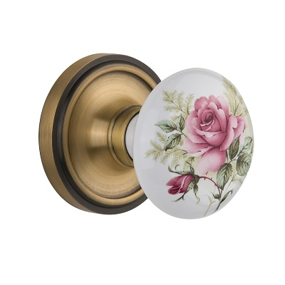 Nostalgic Warehouse Rose Porcelain Knob with Classic Rose Antique Brass
