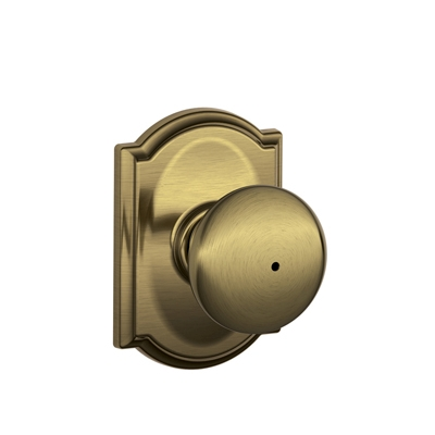 Schlage Plymouth Knob with Camelot Decorative Rose in Antique Brass