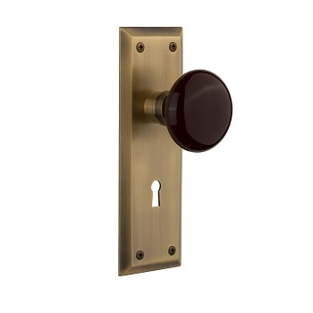 Nostalgic Warehouse New York Backplate with Brown Porcelain knob Antique Brass