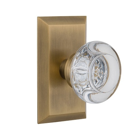 Nostalgic Warehouse Studio Plate with Round Clear Crystal Knob Antique Brass