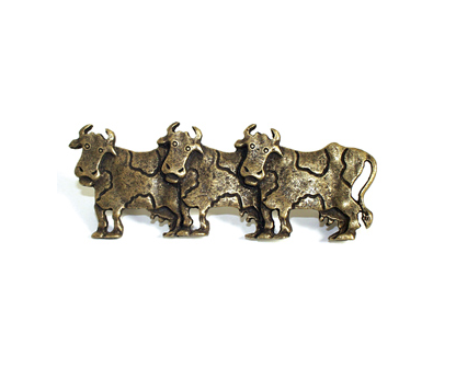 Emenee OR254 Cow Cabinet Pull facing Left shown in Antique Matte Brass (ABR)