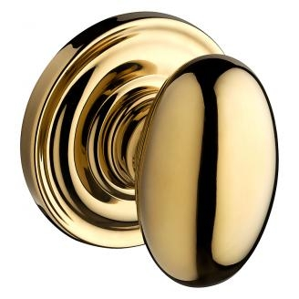 Baldwin Reserve Ellipse Knob with round rose (TRR) shown in Polished Brass (030)