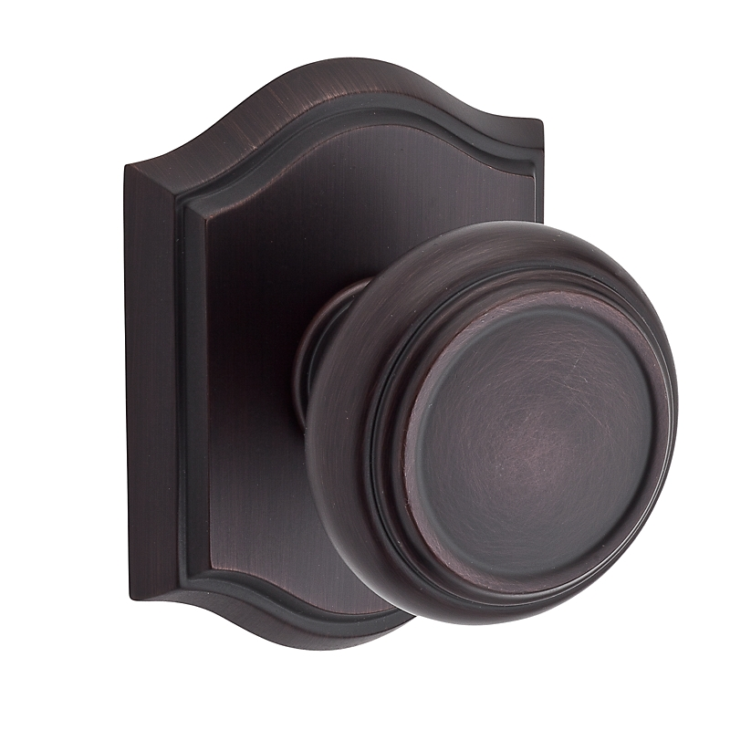 Baldwin Reserve Traditional Knob shown with Arch Rose in Venetian Bronze (112)