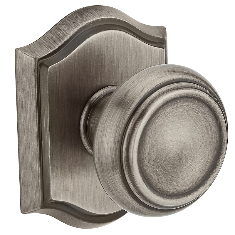 Baldwin Reserve Traditional Knob shown with Arch Rose in Matte Antique Nickel b